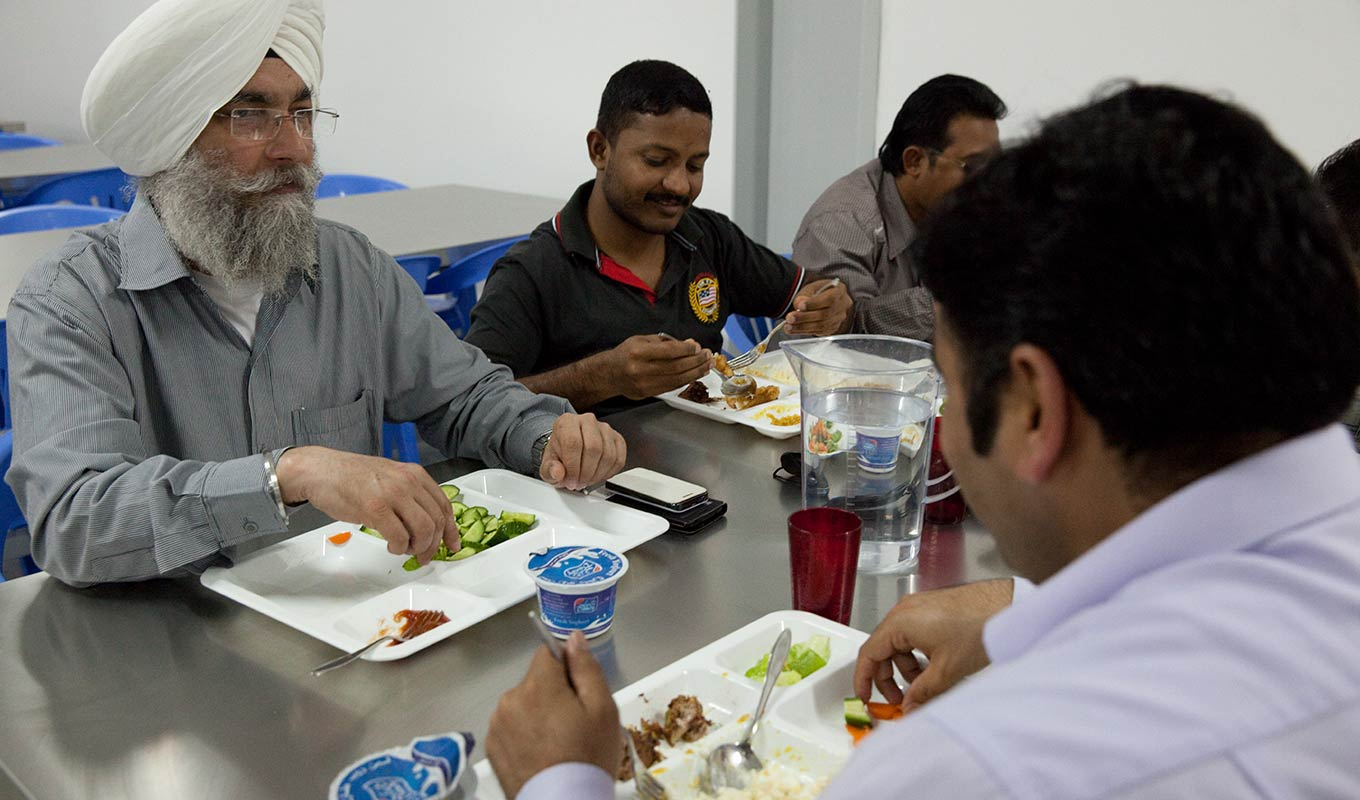 Labour camp staff eating by Newrest Gulf in Qatar